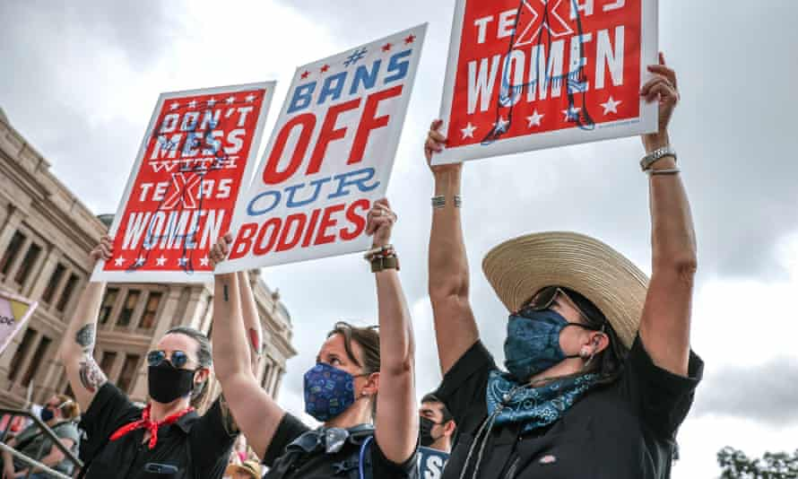 Women's rights advocates participate in the nationwide Women's March, held after Texas rolled out a near-total ban on abortion procedures and access to abortion-inducing medications, in Austin, Texas, at the weekend.